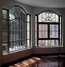 Puertas y ventanas de madera y de madera con aluminio for Ventanales elevables